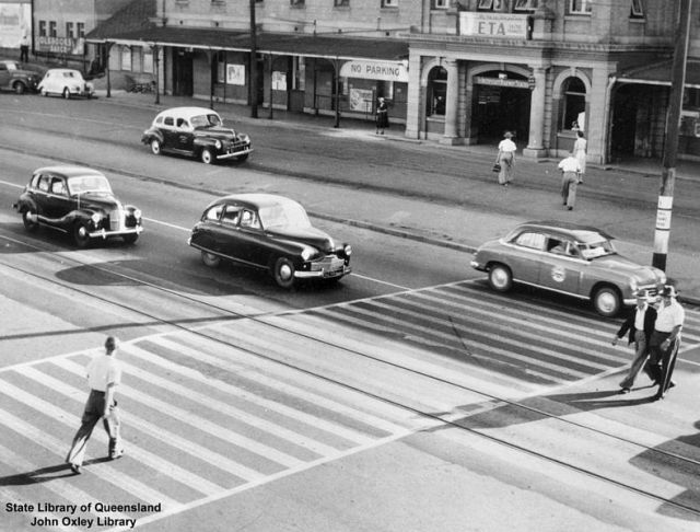 StateLibQld_1_270329_Pedestrians_crossing_the_road_in_front_of_South_Brisbane_Railway_Station,_1954